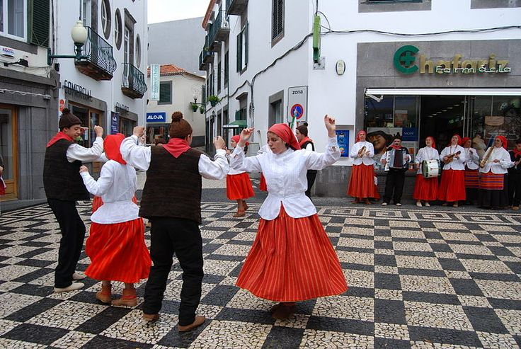 Traditional dancers during the Flower Festival, Funchal, Madeira, Portugal.