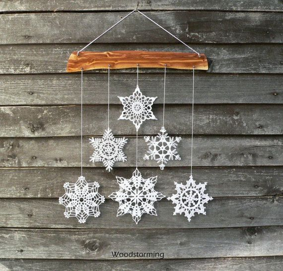 This Christmas holiday decoration is made of cherry tree wood and 6 white crocheted snowflakes. Every single piece of this decoration is made with