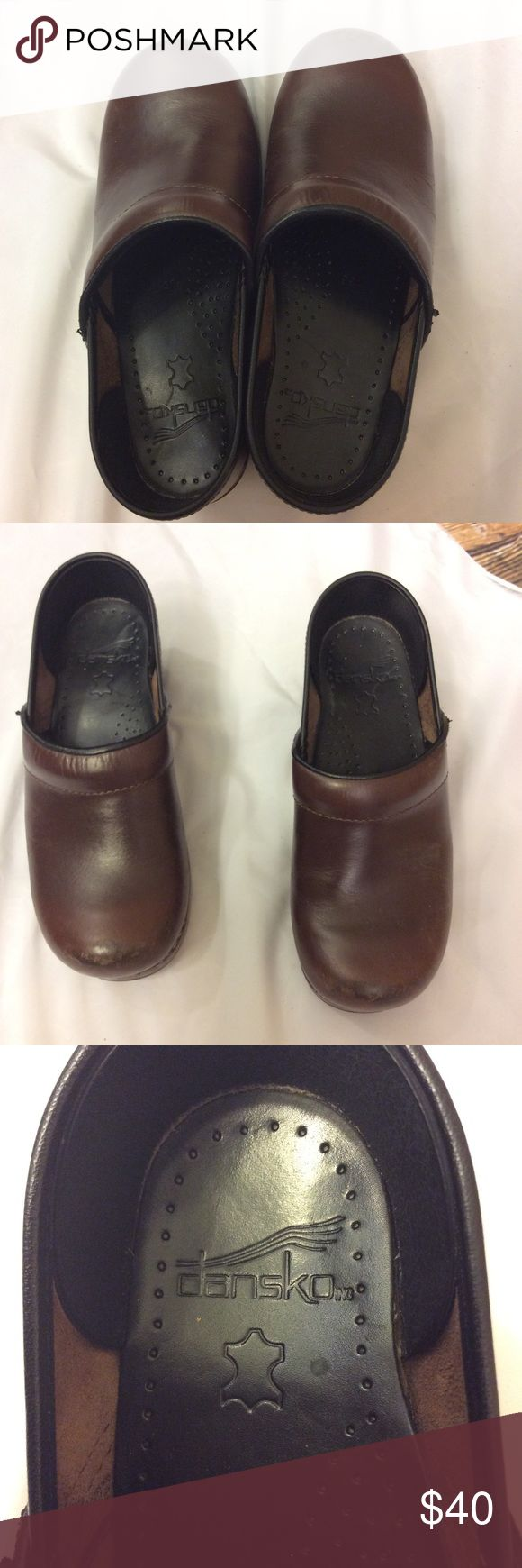 Dansko brown clog size 36 Good preowned condition Dansko brown clogs Shows some  wear on heels Inside is very clean Toes show minor scuffing Size 36 Length from toe to heel 9 1/4 inches measurement taken from inside Width 3 1/4 inches Dansko Shoes Mules & Clogs