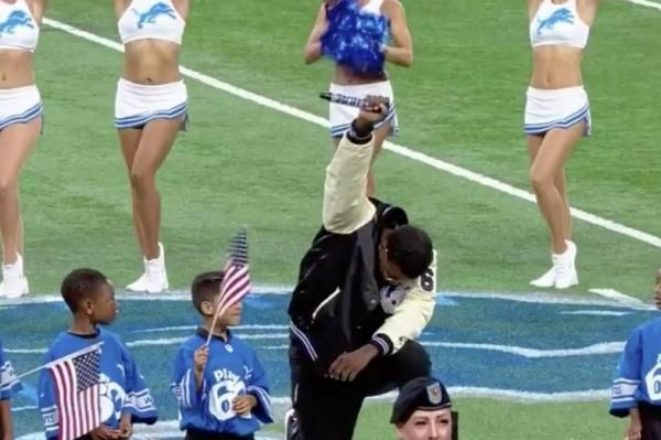 Detroit signer Rico Lavelle sang the national anthem Sunday at Ford Field, before taking a knee and raising his fist to the crowd.