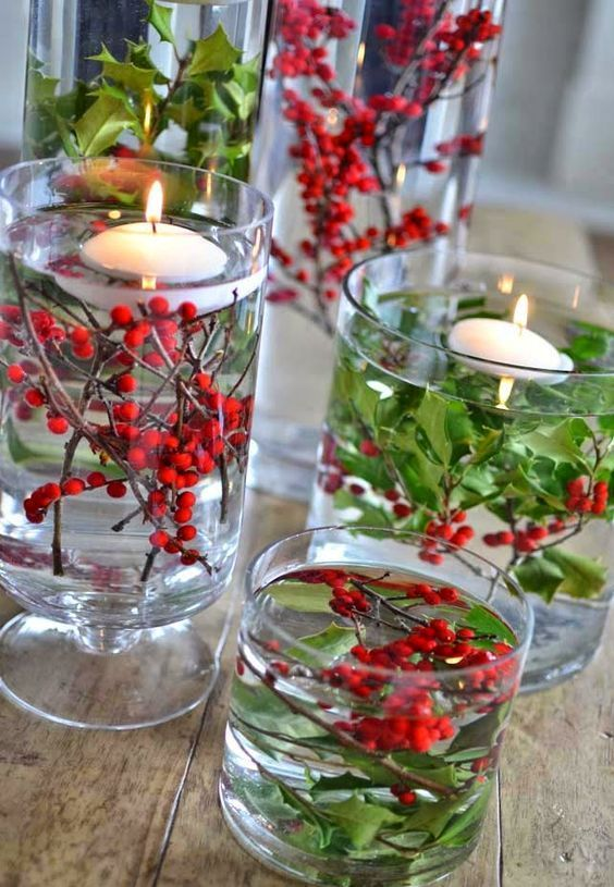 easy holly centerpiece in a glass vase with floating candles