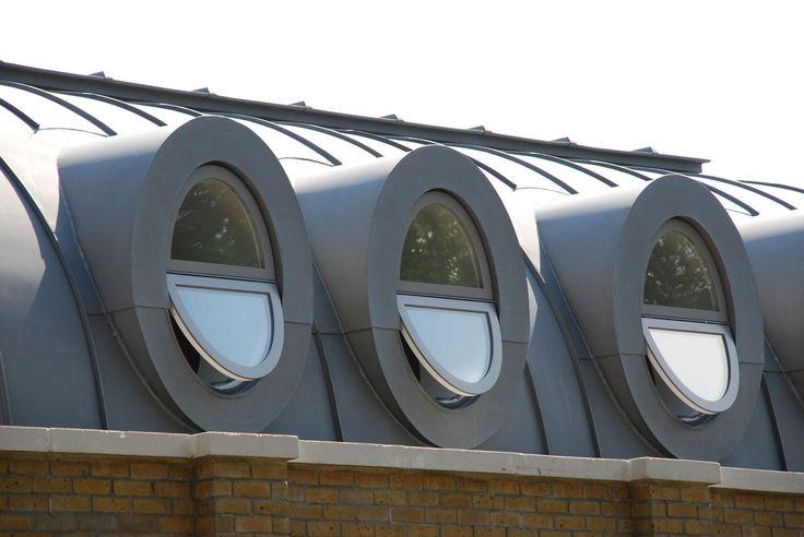zinc-standing-seam roof with round dormer windows