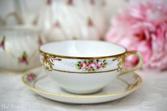 Nippon Hand Painted Teacup And Saucer Set by TheTeacupAttic