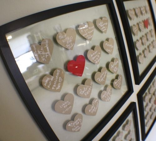 I really love this idea! ...ask guests to write down marriage advice on a cut out heart, then pull them together in a frame!