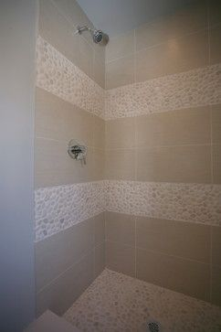 Interesting idea to take the tile pattern from the floor and use it as a trim on the shower walls.