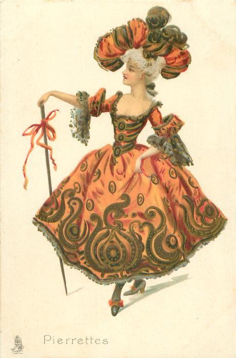girl in elaborate orange dress wears fancy hat, holds long cane dances front, faces slightly left