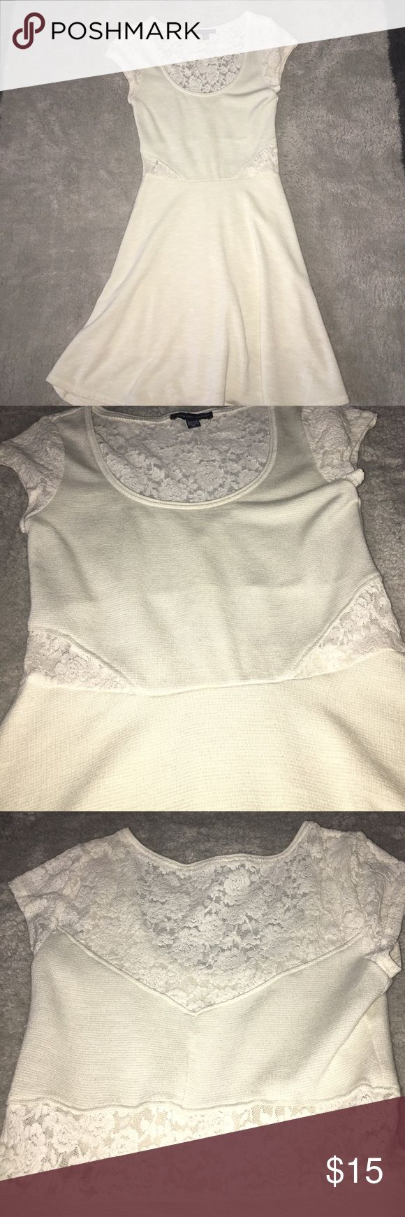 Beige Mini Dress Worn only once!! Low cut in the front and snug to the waist American Eagle Outfitters Dresses Mini