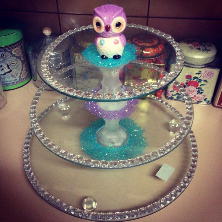 Recycled cake stand with wobbly poles, replacing them with candlesticks and an owl ornament from Typo. The glitter is to cover the marks left from the super glue.