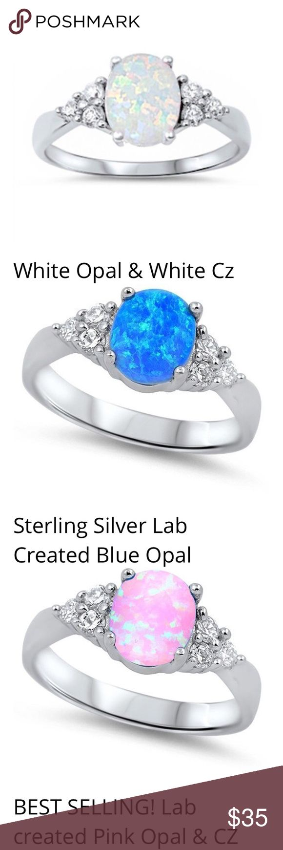 Sterling silver 925 australian opal ring Sterling silver 925 oval australian fire opal ring 6x10 center stone 3 mm cz on both side 2mm band ring rhodium for anti turnish .available in white opal blue opal and ligth blue opal pink opal . Jewelry Rings