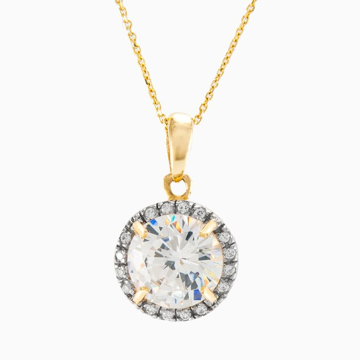 Elegant and graceful, this gold pendant showcases a circle of sparkling micropavé crystals to frame your center round crystal, set in 14k yellow gold. The chain is not included.