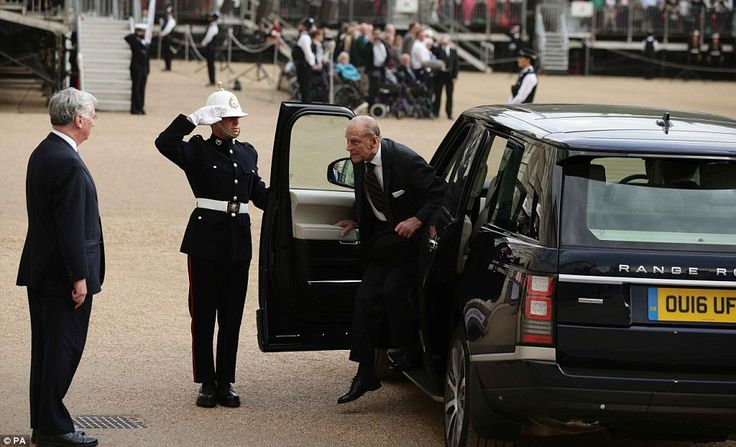 The Duke of Edinburgh is greeted by Defence Secretary Michael Fallon as he arrives to attend the ceremony of Beating Retreat