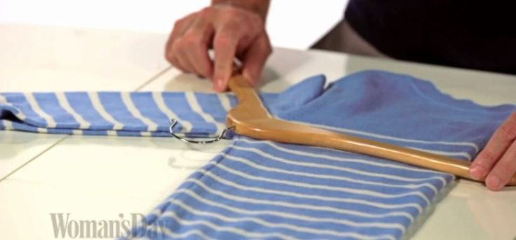 This video from Woman's Day shows you how to hang sweaters without stretching them.