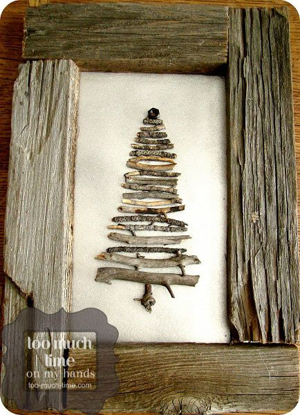 stick tree with frame made from old fence wood. need to make one of these. like the silvered background.