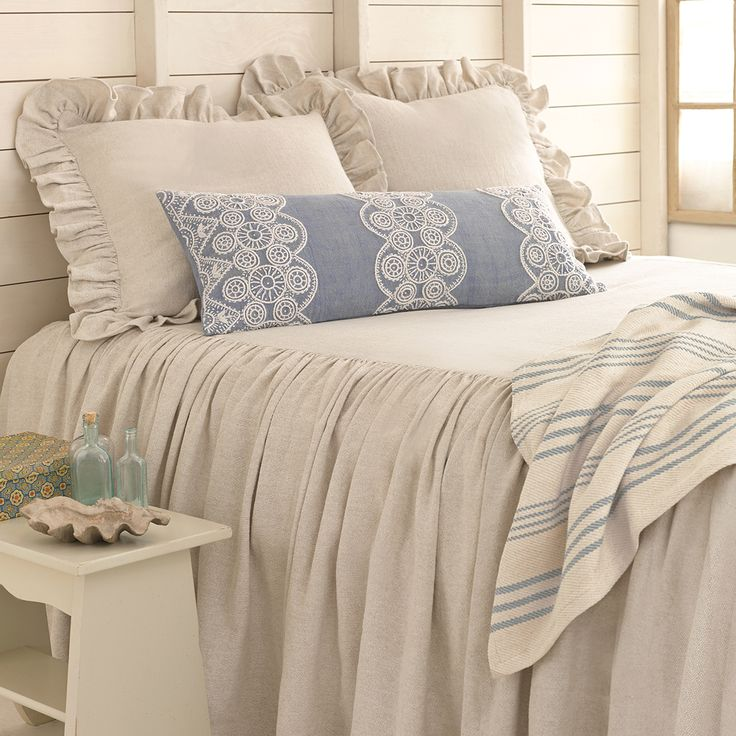 #PineConeHill   BEDROOM  Linen love! Pair our natural bedspread and ruffled shams with a classic striped throw and a detail-rich embroidered decorative pillow.
