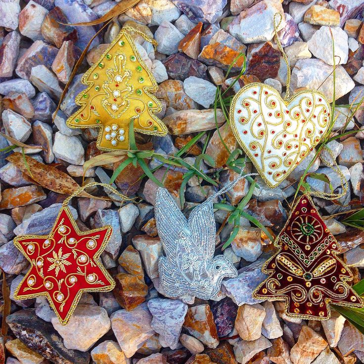 Our set of hand-embroidered ornaments from India! www.christmaswithaheart.com