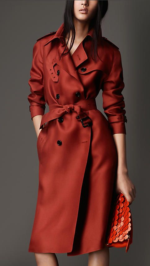 Burberry Russet Oversize Silk Gazar Trench Coat - A lustrous silk gazar trench coat with raglan sleeves for an oversize silhouette. The design is complete with heritage-inspired epaulettes, storm shield and belted cuffs. Discover the women's outerwear collection at Burberry.com
