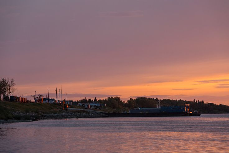Sunrise along the Moose River shoreline in Moosonee. Boxcars to barges.