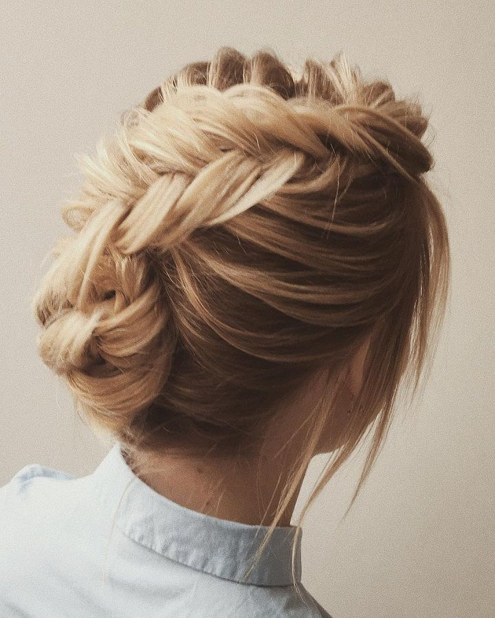Beautiful loose braided updo wedding hairstyle | fabmood.com #hairstyle #chignon #weddinghairstyle #updoideas #bridehair #braidupdo #weddinghairstyles
