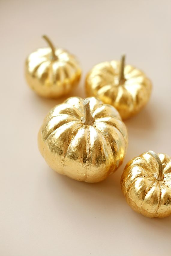 How To Gold-Leaf a Pumpkin - perfect to transform Halloween mini pumpkins into something for Thanksgiving
