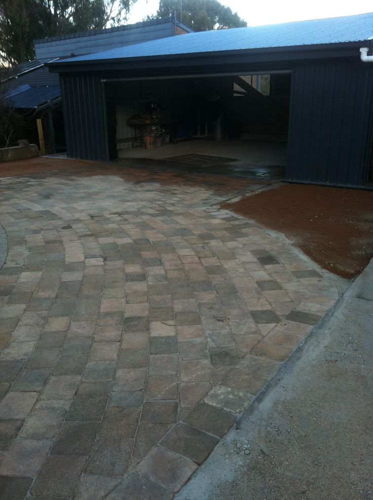 www.pavingcanberra.com  Driveway paving, Recycled paver and compacted red granite area.