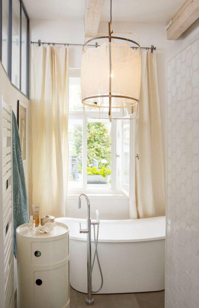 White elegant women bathroom. French style. The bathtub stands by itself. Ay Illuminate hanging lamp. #bathroom #envy #interiors #interiordesign #decor #design #style #styling #home #living #love #igdaily #dailyinspo #instagood #designblog #perfect #mood #beautiful #blog