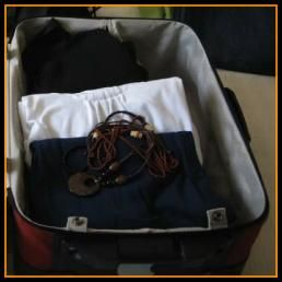 Suitcase opened for packing for a trip, tips on how to pack a suitcase.