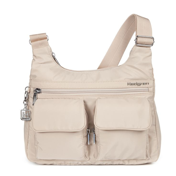 The Prarie shoulder bag has a very practical shape to wear as shoulder bag or as a crossover bag. It has zip pockets, an organiser to put away your agenda, pen rings and much more.