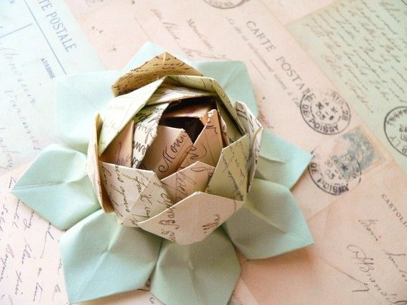 "origami lotus flower, approximately 5"" across, was handmade using an exquisite Italian paper printed with vintage french postcards -- ""Cartes Postale""."
