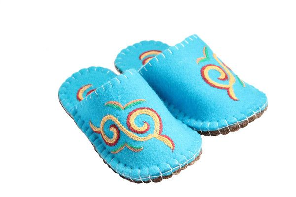 Felt Slippers are hand stitched with patterns reflecting the traditional designs of the Kyrgyz people. The nose of the slipper is turned up ...