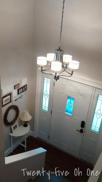 Split level Entry way with oil rubbed bronze chandelier.