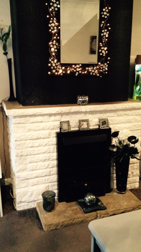 Before pic of white brick fire place, planning on a revamp with a grey/ white wash look.