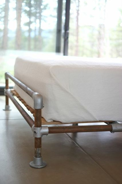 Industrial bed frame with white linens