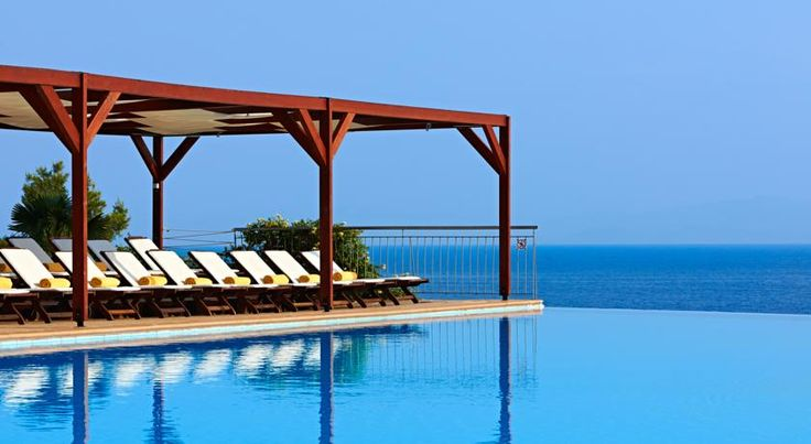 How Alia Palace Luxury Hotel and Villas Makes You a Better Traveler #infinitypool #greece