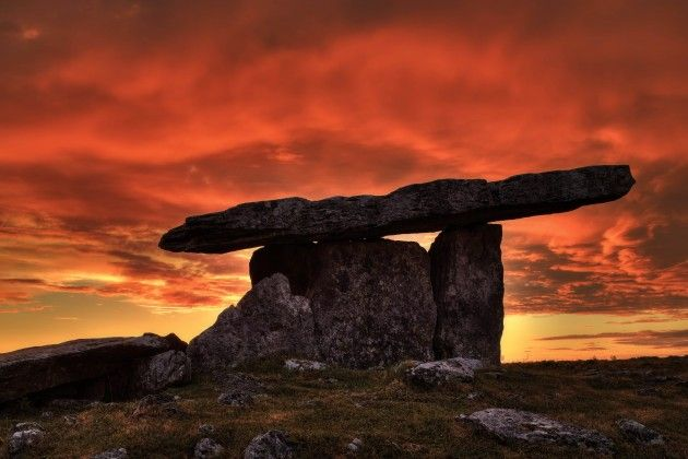 """The magnificent fiery light at sunset provides a dramatic backdrop to this most famous of Irish dolmens (Poulnabrone), located in the Burren of County Clare, looking as if it were a lasting statuesque survivor as the world goes down in Armageddon's cataclysmic flames."" Photo: Carsten Krieger"