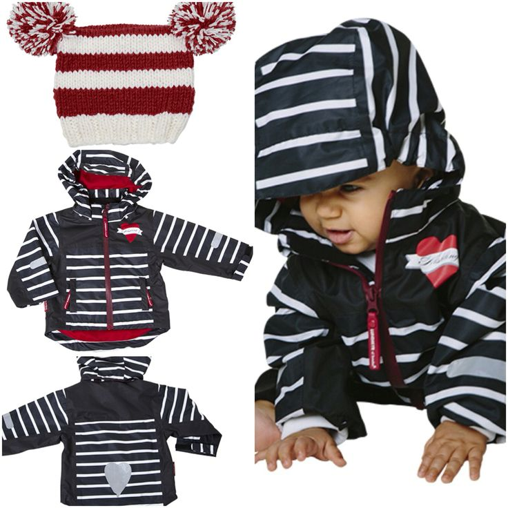 Black  and white striped shelljacket made of wind- and waterproof material with taped seams and red lining. The jacket is made with waterproof 5000mm and a breathability of 3000 g/m2. The jacket has a removable hood with elasticity on sides for a good fit. The bottom of the jacket is adjustable with a drawstring on the inside. The sleeves are pre-bent for increased mobility. Adjustable cuffs with velcro. Available in size 50-120