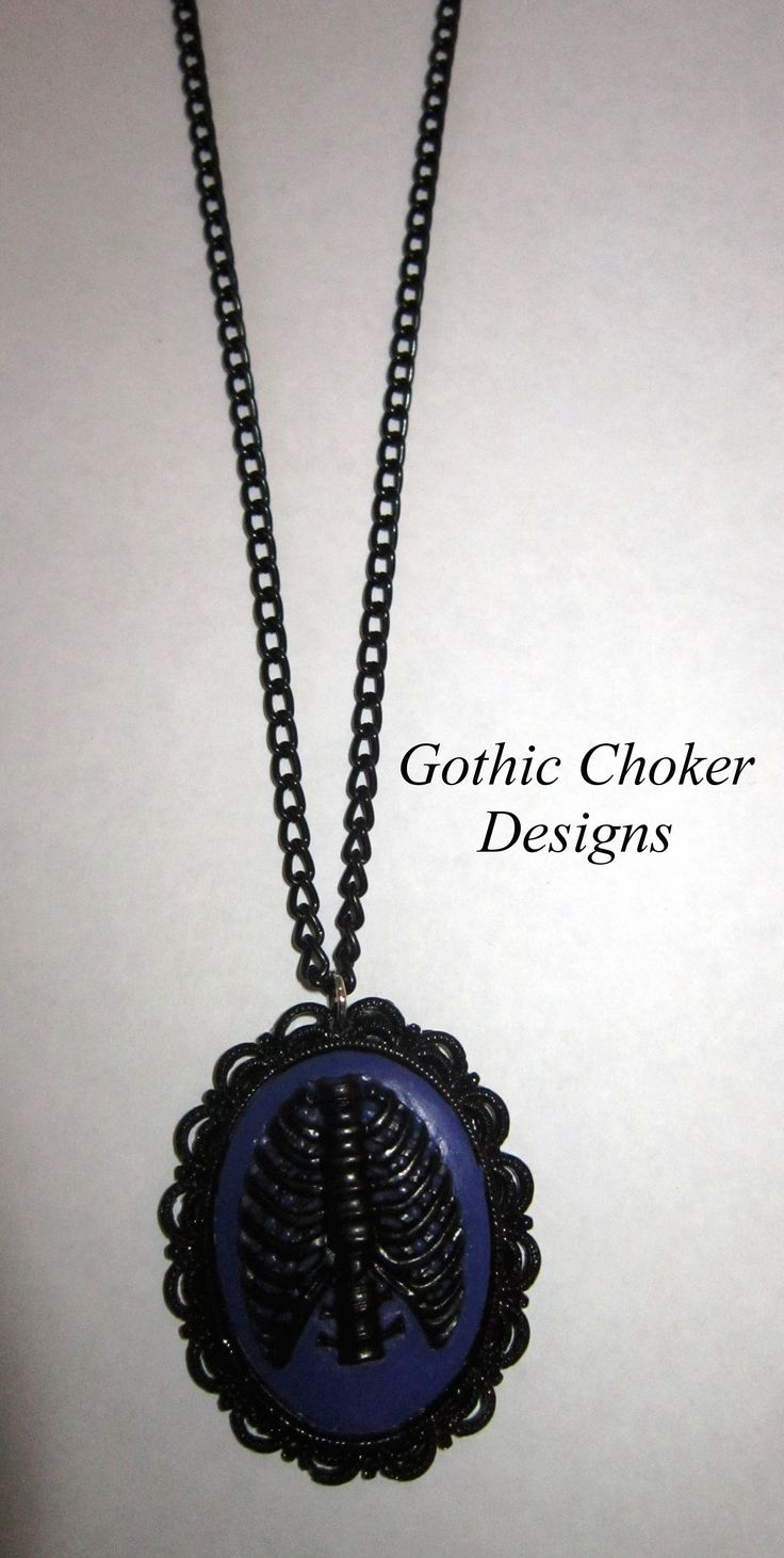 Black ribcage on PURPLE background cameo on black chain necklace. Please note that the cameo is dark purple and not blue as it has come out in the photo. R120 approx $12.  Already been snapped up!!  More are available on order, just waiting for more settings from the supplier