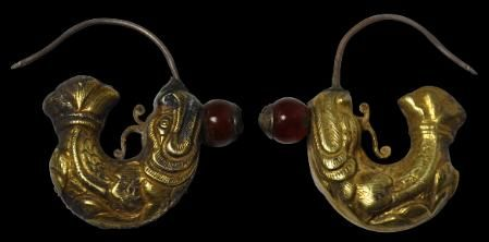 Pair of Gilded silver Dragon-Fish shaped earrings. China Liao Dynasty 10-12 th cent