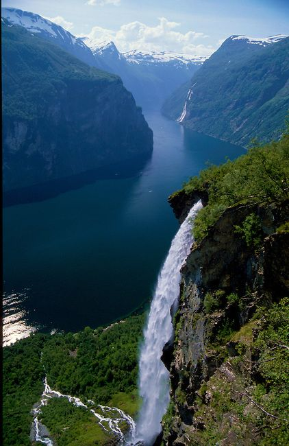 Geirangerfjord is the jewel in the crown of the Norwegian fjords. It is a fairytale landscape with its majestic, snow-covered mountain tops, wild and beautiful waterfalls, lush green vegetation and the deep, blue fjord. http://www.visitalesund-geiranger.com/en/The-Geiranger-fjord/ http://www.geirangerfjord.no/StartPageUK?SiteLanguageVersion=UK