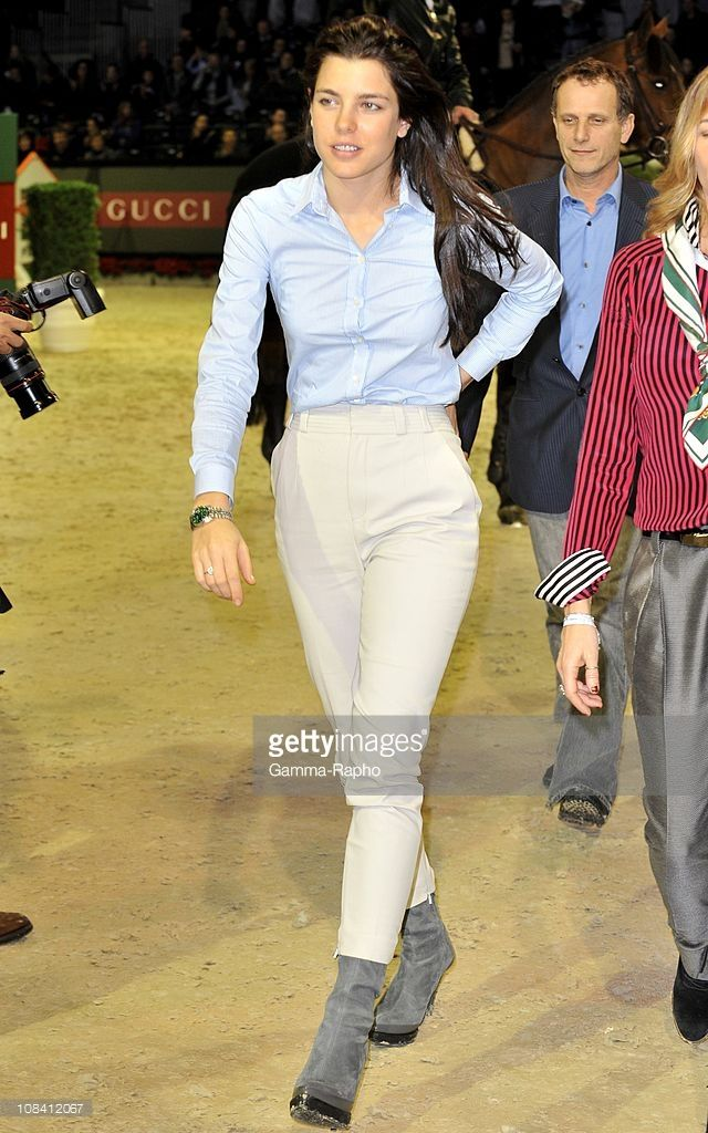 Charles Berling and Charlotte Casiraghi attend the Gucci Grand Prize International Jumping in Villepinte, France on December 13th, 2009.