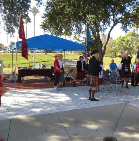 Mayor Shannon Snyder along with members of the Caledonian Club of West Florida & Sarasota Sisters Cities dedicate a memorial to the landing of 65 Scots in 1885 that was the beginning of the city of Sarasota.  The Dec 6, 2013 ceremony was at the the waters edge point of landing at the corner of Main St. & Gulfstream Ave.  The monument was gifted by the City of Glasgow, origin of the Scot migration to Sarasota