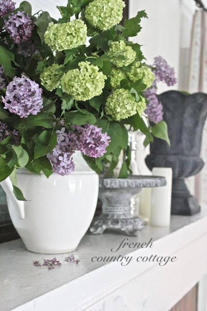 Hearth room: FRENCH COUNTRY COTTAGE: Green & purple bouquet in white pitcher from @HomeGoods