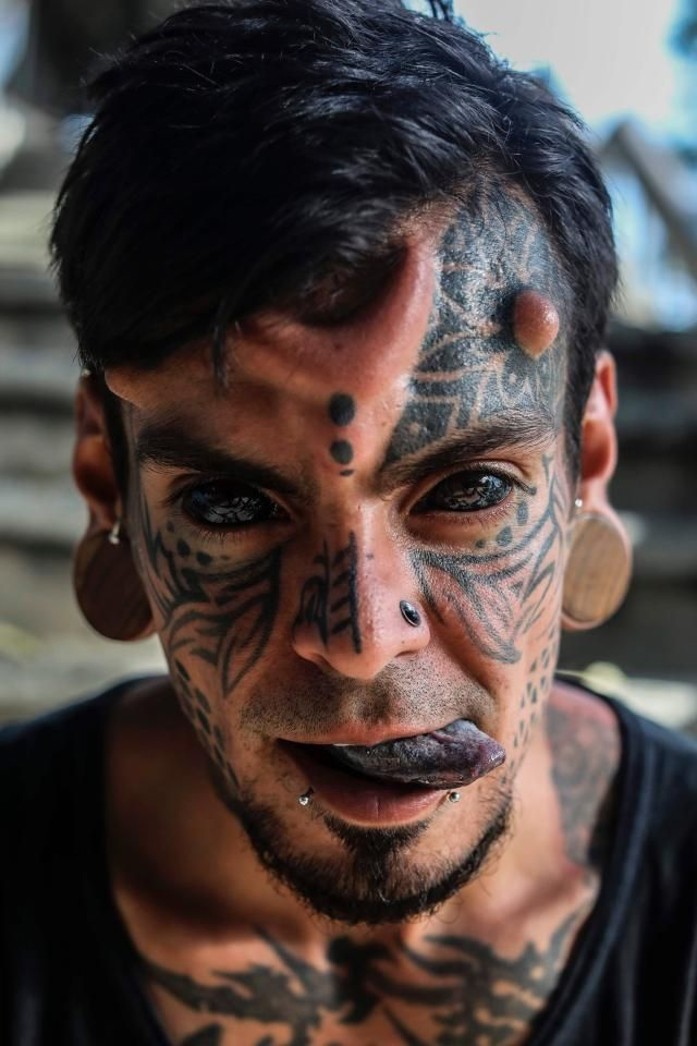 The Colombian also has his TONGUE tattooed as well as huge stretched ear lobes