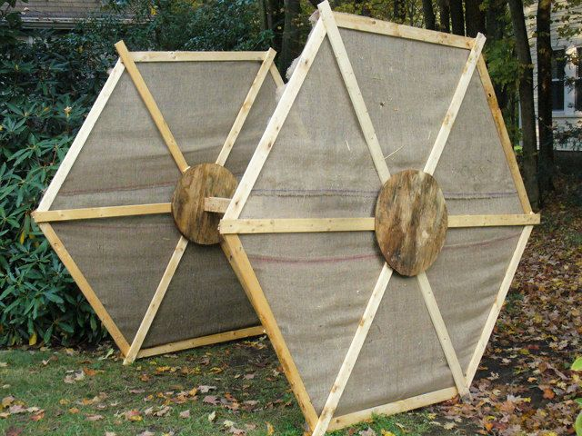 giant star wars scarecrow scene created in front yard tie fighter