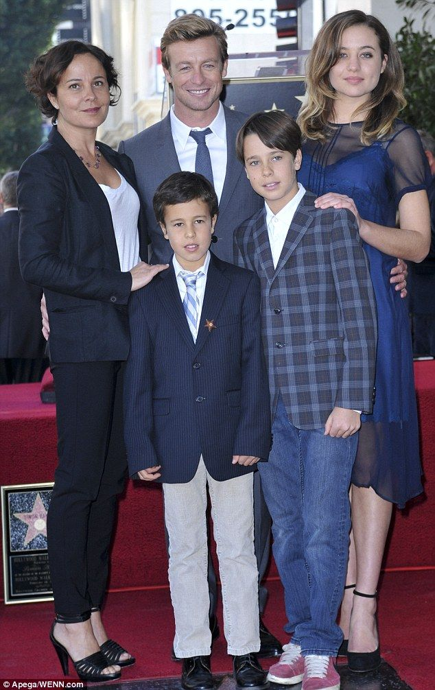 Picture perfect family: Simon posed with his wife Rebecca Rigg and their three children when he was honoured on the Hollywood Walk of Fame i...