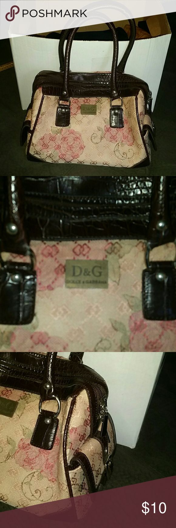 Dolce & Gabana satchel!! **Not sure if it's Authentic, it belonged to my Aunt** there's only one tag inside stating it was made in China! Some wear on straps as shown in pictures! Beautiful rose theme with dark brown trim! Hardware is silver! As always I'm open to offers and I bundle under 5 lb packages, if I have to upgrade the label I get charged the entire shipping amount so I will have to factor that into the price for bundles! Posh DOUBLE DIPS on shipping! I'm a smoke-free home, pug…