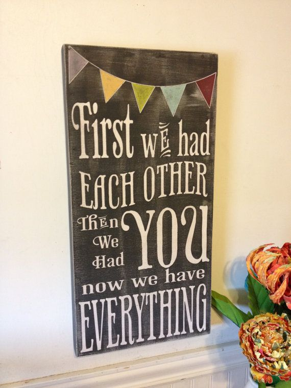 First we had each other wood sign - chalkboard style - vintage lettering - with colored bunting - great gift for nursery or baby shower.. $55.00, via Etsy.