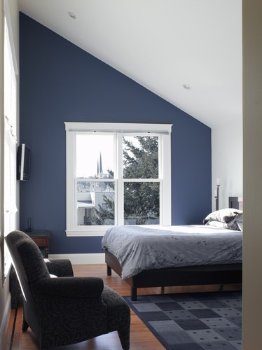 blue feature wall with white window and inclusion of greys into