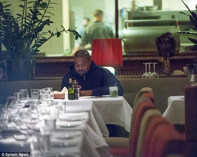 Solo mission: 12 days after welcoming his third child (daughter Chicago), Kanye West cut a lonely figure as he dined by himself at the riverside restaurant Grill Royal in Berlin on Saturday