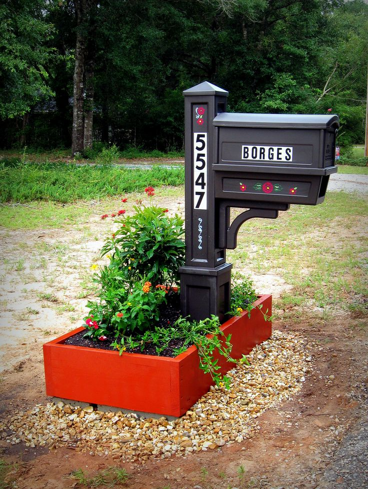 """This simple 2'x4' mailbox planter fits any budget.  You need a 12' length of 2""""x10"""" pressure-treated lumber cut 3 times, five 8""""x4"""" concrete blocks, and solid wood stain.  Once the box is built and stained, lift it over the mailbox and set it on three blocks in the rear and two for the front corners if your ground slopes.  Use a carpenter's level to set it evenly.  Line the base with newspaper for eco-mulch, fill with soil and plants, and put pebbles or sod around the sides to reduce…"""
