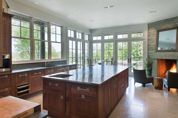 Bruce Willis recently purchased a $12 million, sprawling estate in Bedford, New York, that has this sleek kitchen with amazing views.   - ELLEDecor.com